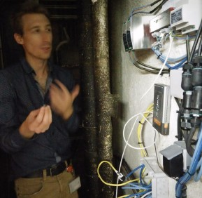 Yoan explains the control system, which is in the crawl space in the building.
