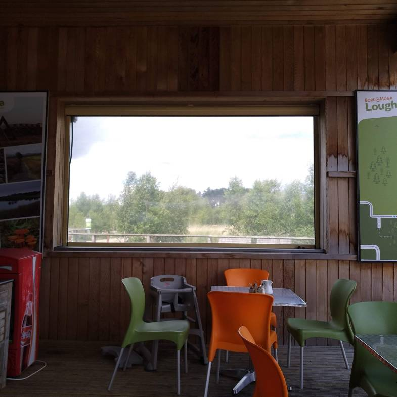 a polythene screen window on the terrace of the Lough Boora Discovery Centre café
